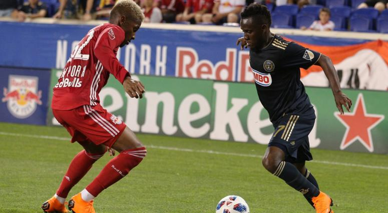 Philadelphia Union forward David Accam (7) plays the ball against New York Red Bulls defender Michael Amir Murillo (62) during the second half at Red Bull Arena.