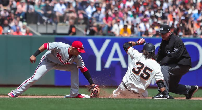 San Francisco Giants shortstop Brandon Crawford (35) gets tagged out by Philadelphia Phillies second baseman Cesar Hernandez (16) while attempting to steal second base during the fifth inning at AT&T Park.