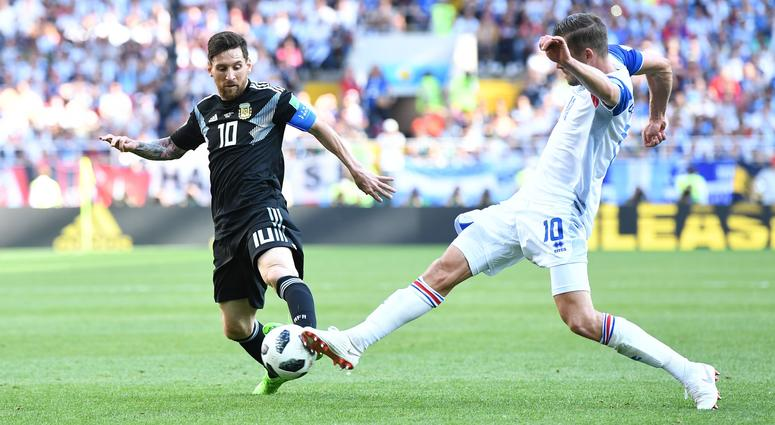 Argentina forward Lionel Messi (10) battles for the ball with Iceland midfielder Gylfi Sigurdsson (10) in Group D play during the FIFA World Cup 2018 at Spartak Stadium.