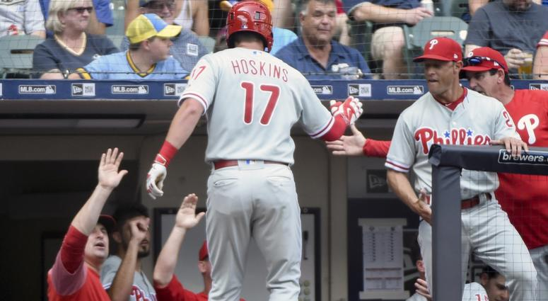 Philadelphia Phillies left fielder Rhys Hoskins (17) is greeted by teammates after hitting a solo home run in the fourth inning against the Milwaukee Brewers at Miller Park.