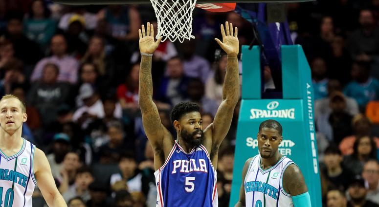 Nov 17, 2018; Charlotte, NC, USA; Philadelphia 76ers center Amir Johnson (5) acknowledges a foul during play against the Charlotte Hornets during the first half at Spectrum Center.
