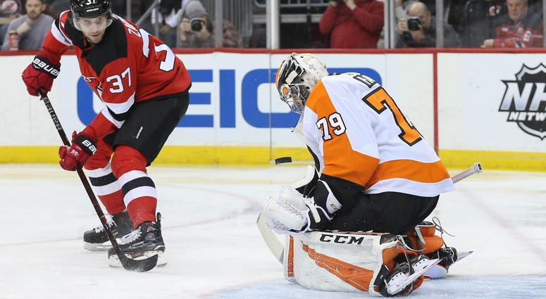 Jan 12, 2019; Newark, NJ, USA; Philadelphia Flyers goaltender Carter Hart (79) makes a save on New Jersey Devils center Pavel Zacha (37) during the second period at Prudential Center.