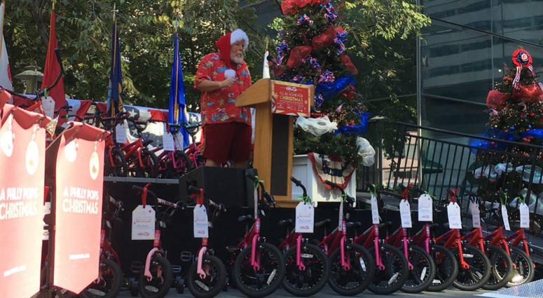 comcast and the philly pops teamed up to give 205 bikes away for christmas in july