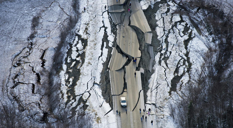 This aerial photo shows damage on Vine Road, south of Wasilla, Alaska, after earthquakes Friday, Nov. 30, 2018.