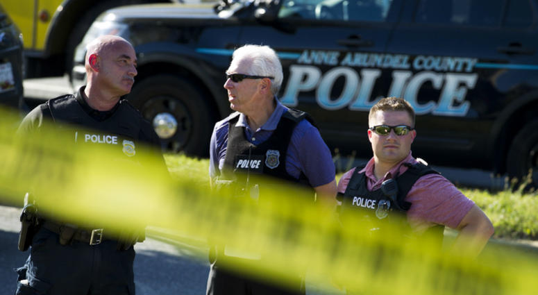 Police officers secure the area after multiple people were shot at an office building housing The Capital Gazette newspaper in Annapolis, Md., Thursday, June 28, 2018.