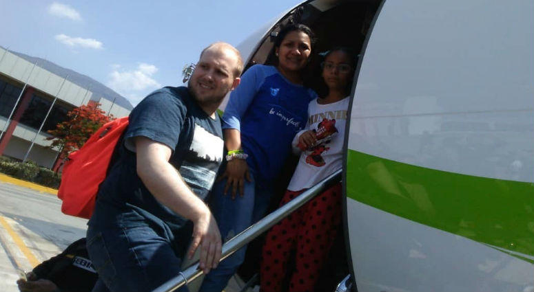 In this image provided by the Holt family, Joshua Holt, his wife Thamara and her daughter Marian Leal, board a plane at the airport in Caracas, Venezuela, Saturday, May 26, 2018.