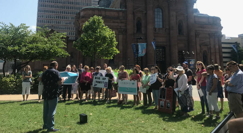 Dozens gathered near the Cathedral Basilica of Saints Peter and Paul to demand action on behalf of victims of clergy sexual abuse.