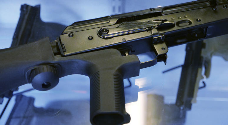 """A """"bump stock"""" is attached to a semi-automatic rifle at the Gun Vault store and shooting range in South Jordan, Utah."""
