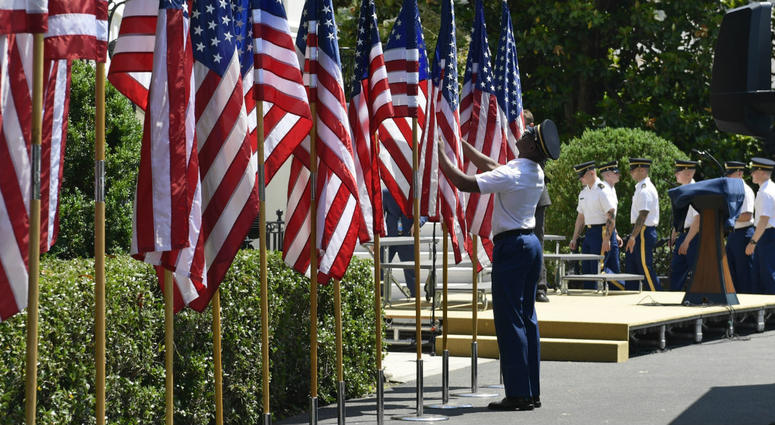 """Members of an honor guard prepare flags for a """"Celebration of America"""" event with President Donald Trump on the South Lawn of the White House in Washington, Tuesday, June 5, 2018."""