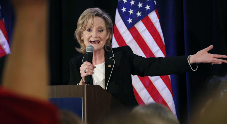 Republican U.S. Sen. Cindy Hyde-Smith calls on her family members to identify themselves as she celebrates her runoff win over Democrat Mike Espy in Jackson, Miss., Tuesday, Nov. 27, 2018.