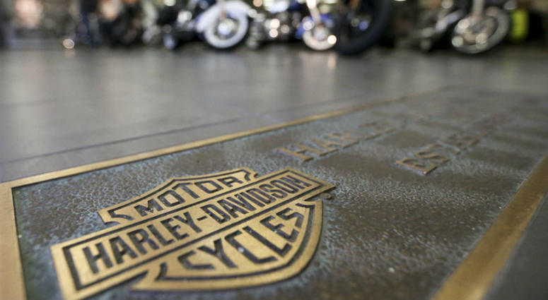 In this April 26, 2017, file photo, rows of motorcycles are behind a bronze plate with corporate information on the showroom floor at a Harley-Davidson dealership in Glenshaw, Pa.