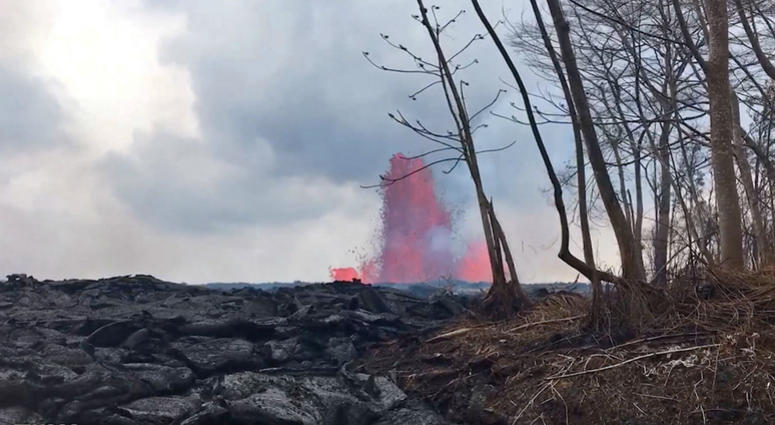 photo from video provided by the U.S. Geological Survey shows lava from a fissure