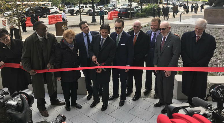 David Adelman, center, with the Philadelphia Holocaust Remembrance Foundation, cuts the ribbon at the Holocaust Remembrance Foundation opening ceremony.