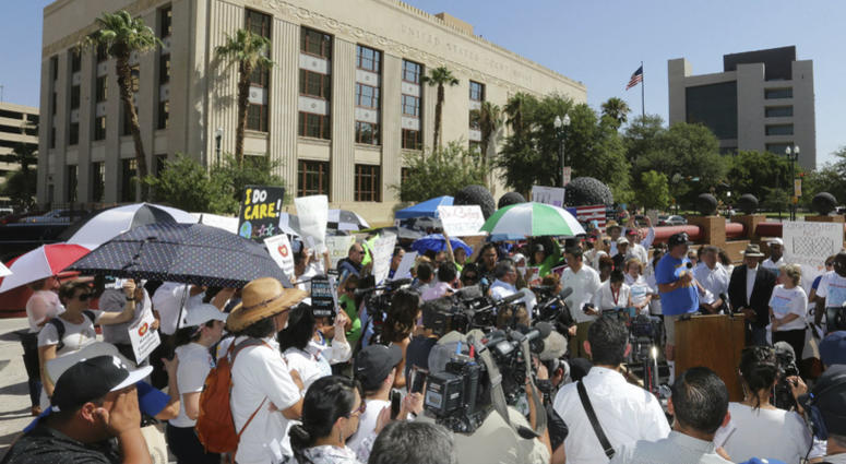 People protest immigration separation policies outside Federal Court, Tuesday, June 26, 2018, in El Paso, Texas. Cases of children and families seeking refugee were being heard inside the courthouse.