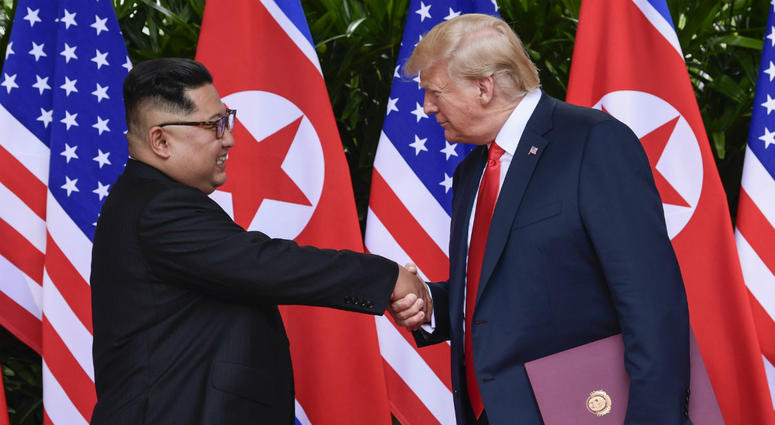 North Korean leader Kim Jong Un, left, and U.S. President Donald Trump shake hands at the conclusion of their meetings at the Capella resort on Sentosa Island in Singapore.