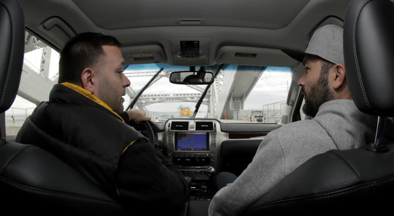 In a photo take Friday, Nov. 9, 2018, Lenny Sciascia, left, talks with his friend Mario DeAngelis as they cross the Bayonne Bridge in Bayonne, N.J., on their way to place online bets on their smartphones in New Jersey.