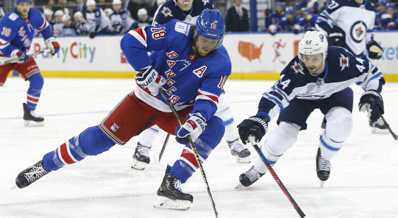 New York Rangers defenseman Marc Staal (18) controls the puck against Winnipeg Jets defenseman Josh Morrissey (44) during the second period of an NHL hockey game, Sunday, Dec. 2, 2018, in New York.