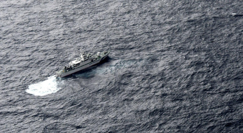 In this aerial photo, Japan's Coast Guard ship is seen at sea during a search operation for U.S. Marine refueling plane and fighter jet off Muroto, Kochi prefecture, southwestern Japan, Thursday, Dec. 6, 2018.