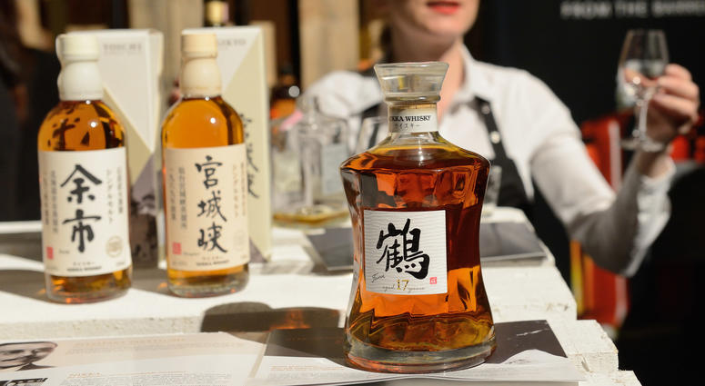 An exhibitor offers Japanese blended whisky for tasting during the 2016 Zagreb Whisky Fair in Zagreb, capital of Croatia, Feb. 26, 2016.