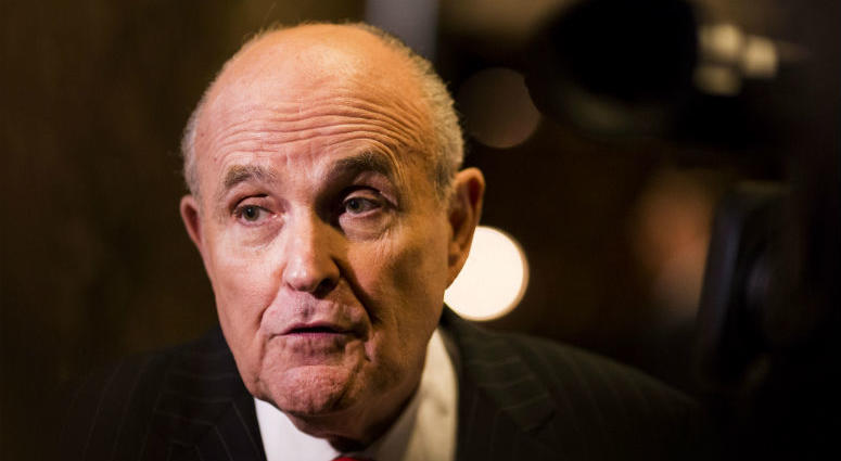 Rudolph Giuliani speaks with reporters at Trump Tower in Manhattan, New York,