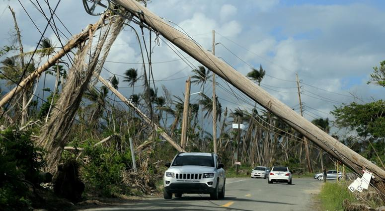 A view of electrical poles torn down along roads in Playa Punta Santiago in Humacao, Puerto Rico, that were destroyed by Hurricane Maria, on December 3, 2017. (Photo by Pedro Portal/El Nuevo Herald/TNS/Sipa USA)