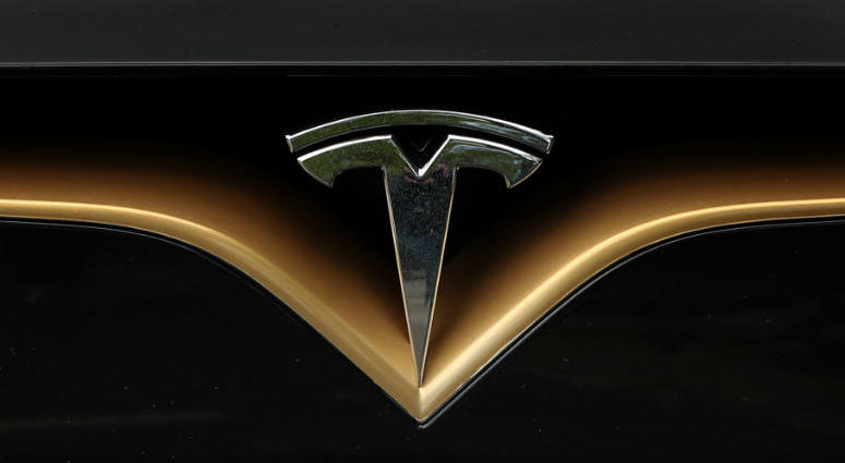 A Tesla logo on the front of a Tesla Model S car at a launch event for the MobilityX self-driving conference, a gathering of global autonomous vehicle leaders, in Dublin