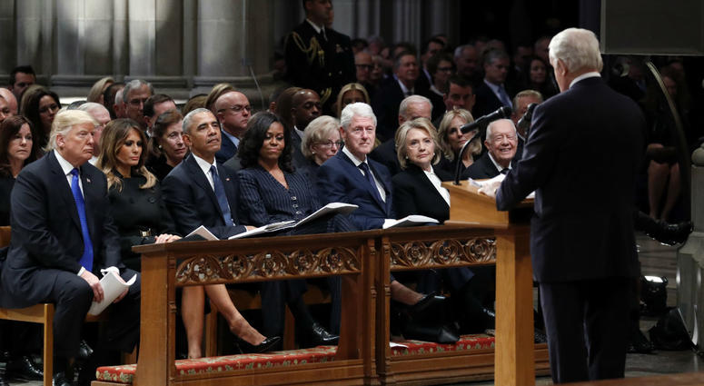 From left: Donald Trump, Melania Trump, Barack Obama, Michelle Obama, Bill Clinton, Hillary Clinton and Jimmy Carter listen as former Canadian Prime Minister Brian Mulroney speaks during a state funeral for George H.W. Bush at the National Cathedral.
