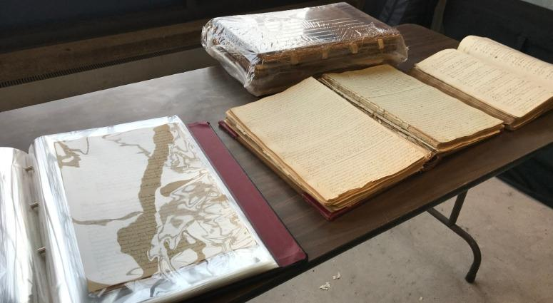 Old deed books (right) next to the newly restored deed books in Bucks County.