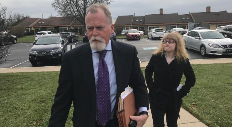 Tina May Smith, right, and her lawyer, Robert Goldman, arrive at a preliminary hearing in New Britain.