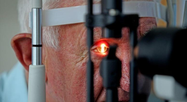 Partially sighted pensioner Raymond Flynn, 80, from Audenshaw, Manchester, has his sight checked by surgeon Professor Paulo Stagna from The Wellcome Trust Clinical Research Facility at University Manchester Hospital.