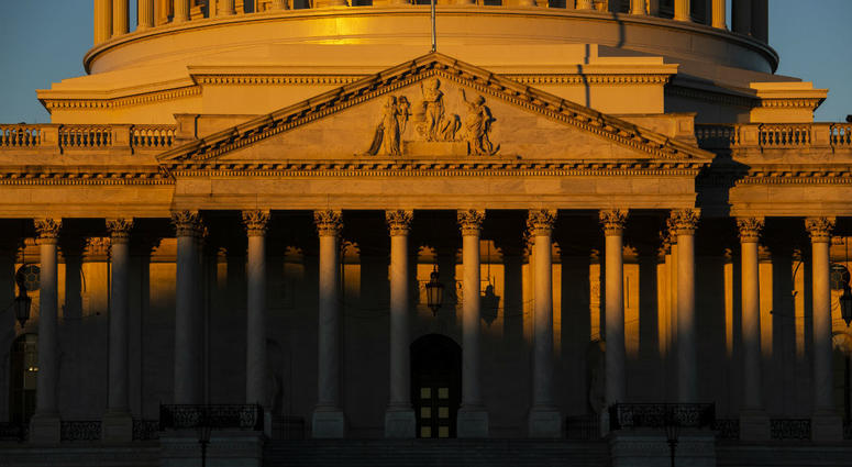 The Capitol is seen at dawn on the 21st day of a partial government shutdown as an impasse continues between President Donald Trump and Democrats.