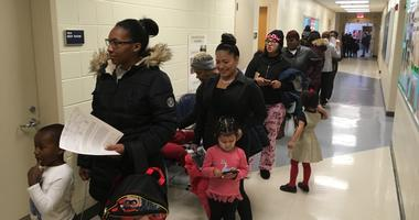 Parents line up with their toddlers at the Early Childhood Development Center in Camden for free flu shots.