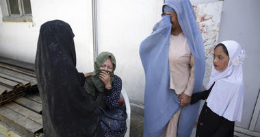 Women cry in a hospital after they lost their children in a deadly suicide attack on a voter registration center in Kabul, Afghanistan, Sunday, April 22, 2018. Gen. Daud Amin, the Kabul police chief, said a suicide bomber targeted civilians who had gather