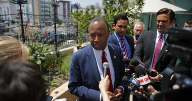 Housing and Urban Development Secretary Ben Carson talks to reporters at the Downtown Women's Center.