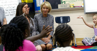 Education Secretary Betsy DeVos accompanied by first grade teacher Angela Snyder speaks to students, during a visit of the Federal School Safety Commission at Hebron Harman Elementary School in Hanover, Md.
