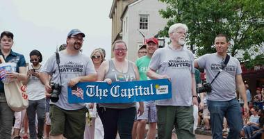 Current and former Capital Gazette staff members march in the Annapolis 4th of July parade in Annapolis, Md., Wednesday, July 4, 2018.