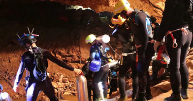 Thai rescue team members walk inside a cave where 12 boys and their soccer coach have been trapped since June 23, in Mae Sai, Chiang Rai province, northern Thailand.