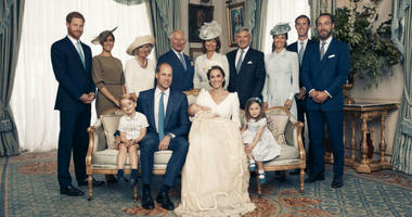 Duke and Duchess of Cambridge shows the official photograph to mark the christening of Prince Louis at Clarence House, following Prince Louis' baptism, in London.