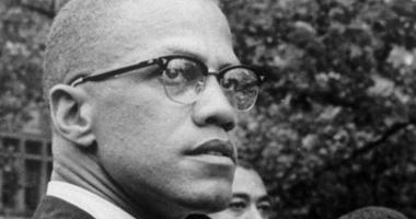In this 1963 file photo, Black Nationalist leader Malcolm X attends a rally at Lennox Avenue and 115th Street in the Harlem neighborhood of New York.