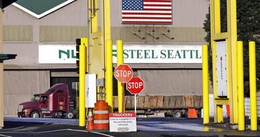 In this Feb. 25, 2016 file photo, a truck carries a load at the Nucor Steel plant in Seattle.