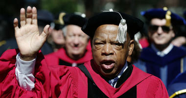 In this May 24, 2018 file photo, U.S. Rep. John Lewis walks in a procession during Harvard University commencement exercises in Cambridge, Mass.