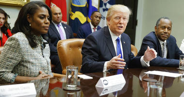 In this Feb. 1, 2017, file photo, President Donald Trump, center, is flanked by White House staffer Omarosa Manigault Newman, left, and then-Housing and Urban Development Secretary-designate Ben Carson