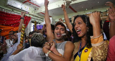 Supporters and members of the LGBT community celebrate after the country's top court struck down a colonial-era law that makes homosexual acts punishable by up to 10 years in prison, in Mumbai, India.