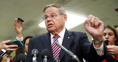 Sen. Bob Menendez speaks to members of the media.