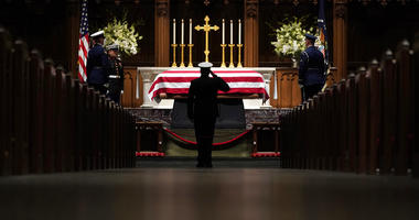 People pay their respects as the flag-draped casket of former President George H.W. Bush lies in repose at St. Martin's Episcopal Church Wednesday, Dec. 5, 2018, in Houston.