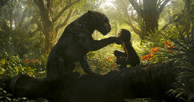 "This image released by Netflix shows Rohan Chand as Mowgli, right, and the character Bagheera, voiced by Christian Bale, in a scene from the film, ""Mowgli: Legend of the Jungle,"" streaming on Netflix on Friday."