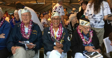 Tom Berg, left, of Port Townsend, Wash., Robert Fernandez, center, of Stockton, Calif., and George Keene of Newhall, Calif., all survivors of the 1941 Japanese attack on Pearl Harbor, take part in the 77th anniversary ceremony Friday, Dec. 7, 2018, at Pea