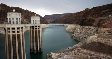 FILE - In this July 28, 2014, file photo, lightning strikes over Lake Mead near Hoover Dam that impounds Colorado River water at the Lake Mead National Recreation Area in Arizona.