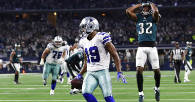 Dallas Cowboys wide receiver Amari Cooper (19) scores a 15-yard touchdown against the Philadelphia Eagles in overtime of an NFL football game, in Arlington, Texas, Sunday, Dec. 9, 2018. Dallas won 29-23.