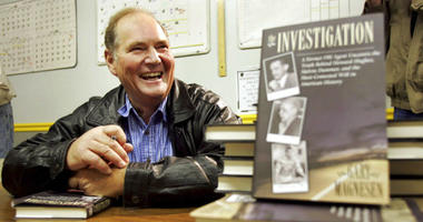 FILE - In this Nov. 10, 2005 file photo, Melvin Dummar smiles after signing copies of a book that Gary Magnesen had written about Dummar's claims that Howard Hughes left him a portion of the Hughes estate.
